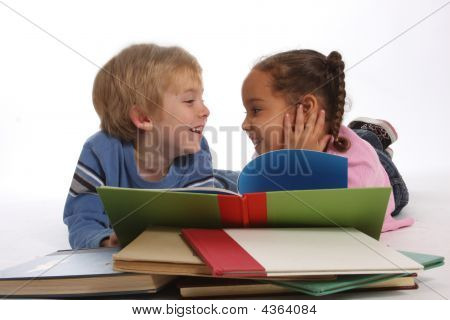 Laughing Kids Reading A Book