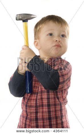 Small Boy Is Keeping Hammer