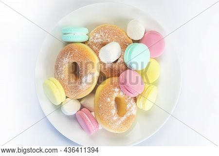 Different Sweets Isolated On White Background, Doughnuts, Macarons Top View, Unhealthy And Candy Con