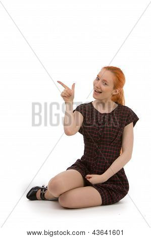 Attractive Woman Pointing To Copyspace