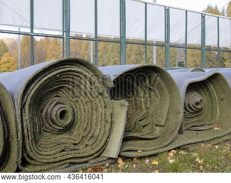 Rolled Up Used Artificial Turf When The Sport Season Ended. Expired Artificial Turf For Athletic Fie