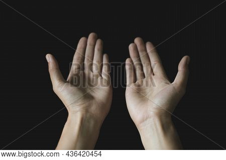 Praying Hands. Black Background. Make A Wish In God. Faith In Religion And Belief In God On The Powe