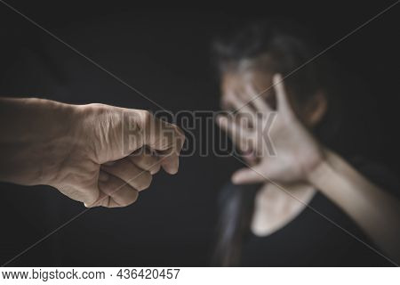 Domestic Violence. Women Are Covering Their Faces With Fear. Women Are Victims Of Abuse And Harassme