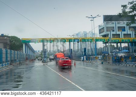 Howrah, West Bengal, India - 17th August 2019 : Shot Through Wet Car Windshield Glass, Toll Tax Coll