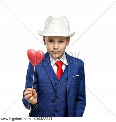 Cute Boy In A Suit And With A Valentine In His Hand