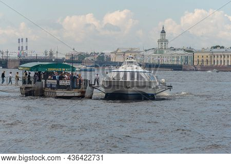 Saint Petersburg, Russia - July 13, 2017: Debarker With Tourists And A Docking Hydrofoil Ship On The