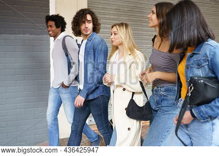 Multi-ethnic Group Of Friends Walking Together On The Street.