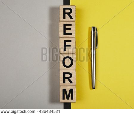 Reform Word On Wood Cubes. Concept Of Pros And Cons Of Amendments.