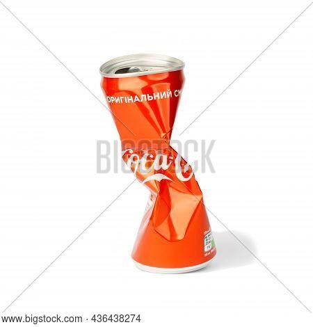 Novoukrainka, Ukraine - October 13, 2021: Squeezed Can Of Coca Cola Isolated On White Background
