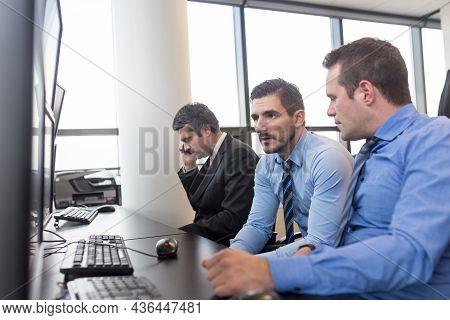 Worried Stock Traders Brainstorming In Corporate Office.
