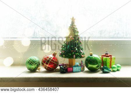 Christmas Evergreen Tree With Decorations On Windowsil