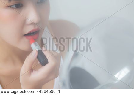 Beautiful Young Asian Woman Applying Lipstick Red On Mouth, Beauty Girl Looking Facial At Mirror For