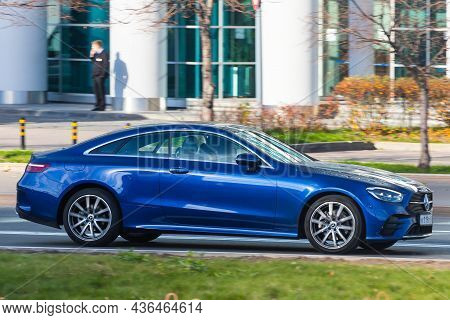 Moscow; Russia - October 14; 2021: Blue Mercedes E-class Coupe  Is Driving Fast On The Street On A W