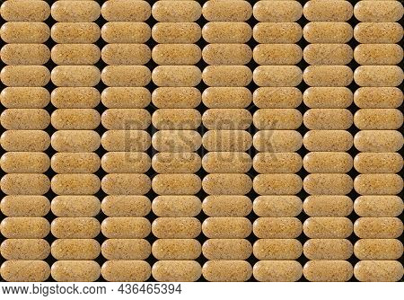 Daily Multyvitamin Pills Macro Background. Seamless Repeating Pattern Of Herbal Brown Tablets Close-