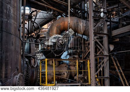 Lots Of Thick, Dirty Pipes. Fragments Of Metallurgical Equipment.