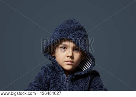 Portrait Of A Little Kid With Hoodie. Cute Multi-racial 8-years Old Boy Wearing Hoodie And Looking I