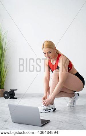 Ready Sport. Athletic Woman. Online Training. Home Fitness. Sportive Lady Tying Shoelace Going To Do