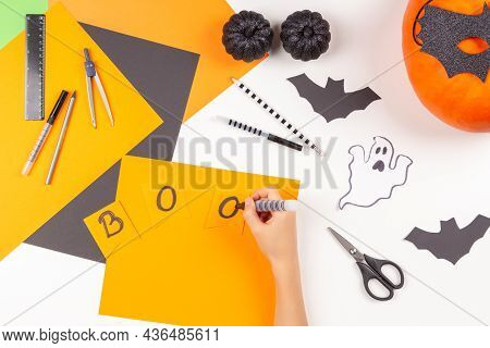 Preparing For Halloween. Teenage Kid Hands Drawing, Cutting Colored Paper And Making Halloween Party