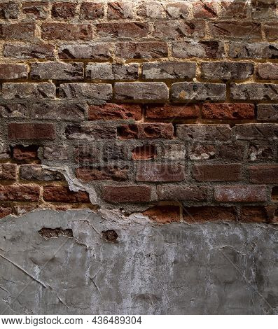 Weathered And Decaying Brick Wall With Multiple Layers Of Concrete And Tuckpointing, Vertical Aspect