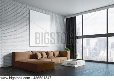 Modern Living Room Interior With Empty White Mock Up Frame On Brick Wall, Big Couch, Other Pieces Of