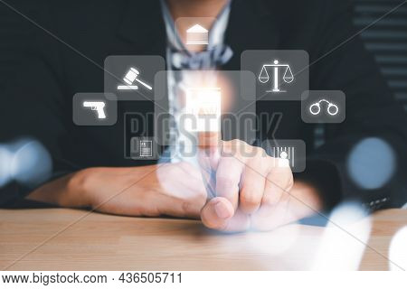 Female Lawyer Hand Touching Holographic Law Icon On Office Desk, Terrorism, Crime, Judgment, Verdict