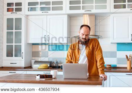 Man Use Laptop For Online Work Education Or Shopping. Portrait Of Bold Bearded Caucasian Man Freelan