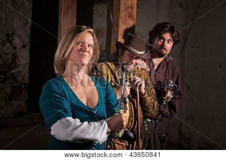 Smirking young woman with nervous friends in medieval character poster