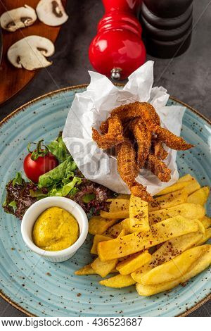 Crispy Coated Deep Fried Chicken Pieces With French Fries And Salad