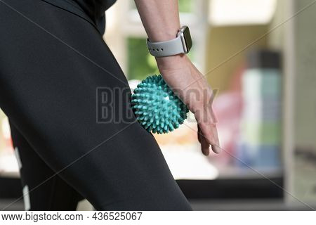 Woman Using Massage Tool For Myofascial Therapy On Thigh Muscles. Roller For Physiotherapy