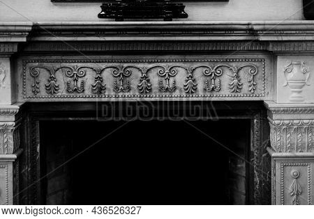 Fireplace In Castle. Classic Decor Of Exquisite Fireplace With Ornamental Elements In Old Mansion Ho