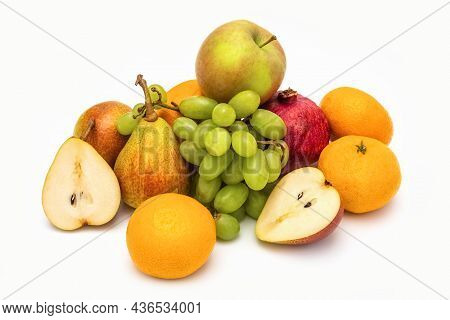 Still Life Of Ripe Fruits On A White Background. Pears, Grapes And Tangerines On A White Background.