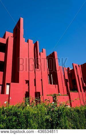 Calpe, Spain - 19 July 2021: Geometric Architecture Of The Postmodern Apartment Building 'la Muralla