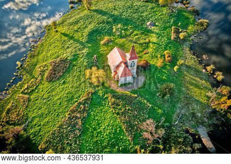 Aerial View Of Church Of St. Linhart In South Moravia On The Island In Stunning Evening Golden Hour