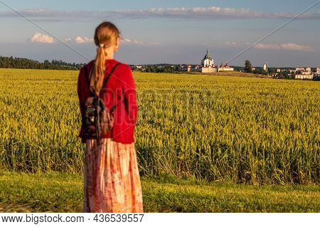 Young Woman In The Landscape Looking Across The Field At The Pilgrimage Church Of Saint John Of Nepo