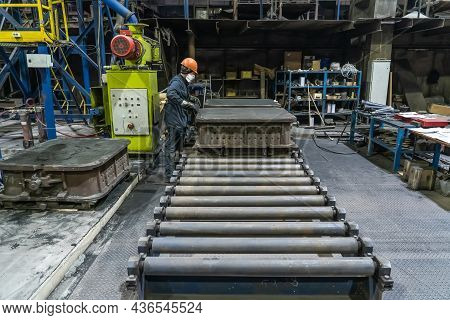 Conveyor Belt Inside Manufacturing Metallurgical Plant Or Factory. Workshop For Working With Molds.