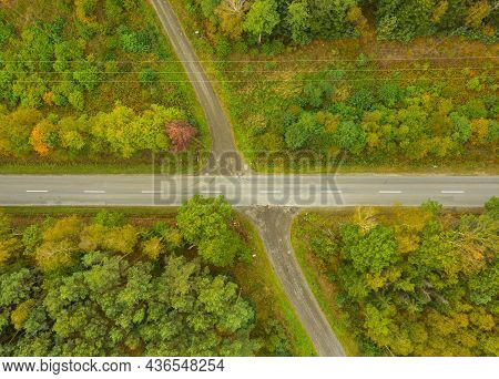 A Vast Plain Covered With Tall Pine Forests. In The Center Of The Frame You Can See The Junction Of