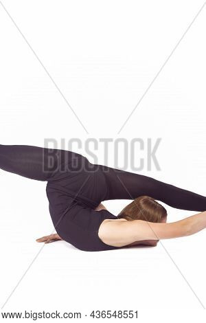 Sport Ideas And Concepts. Young Caucasian Sportswoman Rhythmic Gymnast In Training Black Outfit Duri