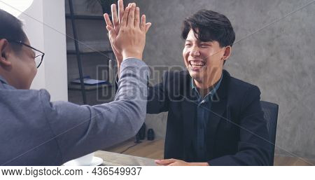 Two Businessmen Talking Together At Office Desk, Business Meeting Room With Happiness And Make High