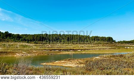a panoramic view over the Gaia River at the El Catllar reservoir, in El Catllar, Catalonia, Spain, with a low level of water in autumn