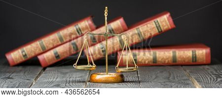 Law Concept - Open Law Book With A Wooden Judges Gavel On Table In A Courtroom Or Law Enforcement Of