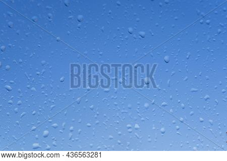 Wet Glass With Raindrops On A Blue Sky Background, Blue Window Glass Background, Raindrops On A Blue