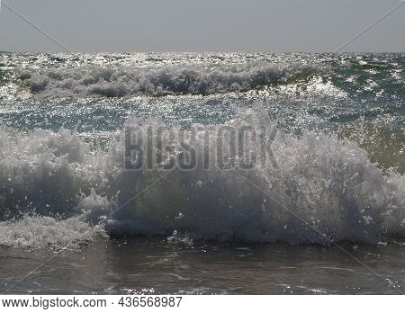 The South Wind Makes Waves At Sea And The Sea Hits The Coas