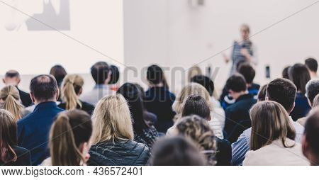 Woman Giving Presentation On Business Conference Event