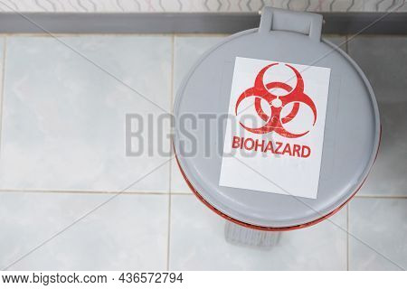 Medical Waste Bin With Biohazard Sign In Hospital. Biohazardous Containers Used To Safely Remove Sha
