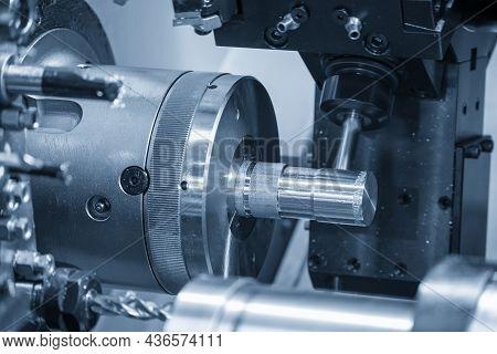 The Multi-tasking Cnc Lathe Machine Cutting The Metal Shaft Part. The Hi-technology Automotive Part