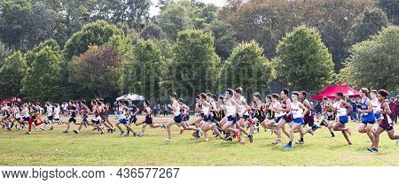 Bronx, New York, Usa - 9 October 2021: Boys Running Fast At The Start Of An Invitational Cross Count