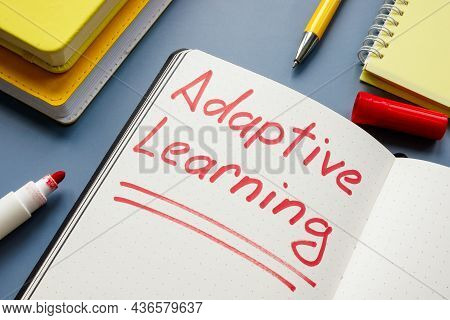 Adaptive Learning Handwritten Sign And Yellow Books.