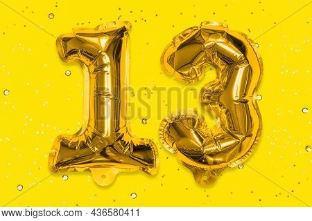 The Number Of The Balloon Made Of Golden Foil, The Number Thirteen On A Yellow Background With Sequi