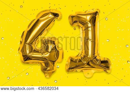 The Number Of The Balloon Made Of Golden Foil, The Number Forty-one On A Yellow Background With Sequ