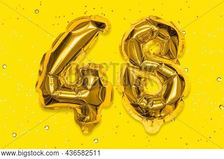 The Number Of The Balloon Made Of Golden Foil, The Number Forty-eight On A Yellow Background With Se